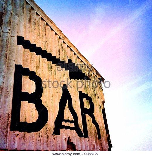 Bar Sign on the Beach - Stock Image