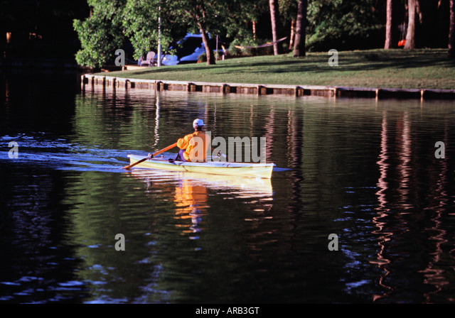 Man rowing scull on Crystal Lake Virginia Beach VA - Stock Image