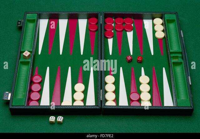 Backgammon board on green baize - Stock Image