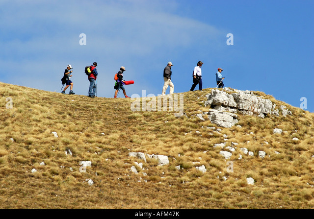 Hikers enjoy the Glorious colour of Sasso Tetto  mountain in the Sibillini National Park,Le Marche,the Marches, - Stock Image