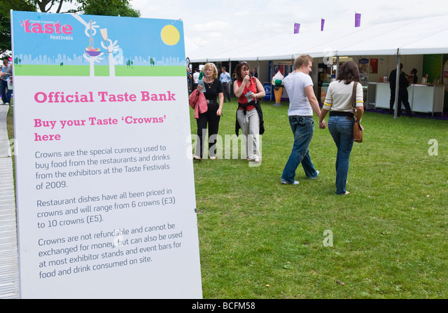 Taste of London , sign for the Official Taste Bank where Crown tokens may be purchased for buying food & drink - Stock Image