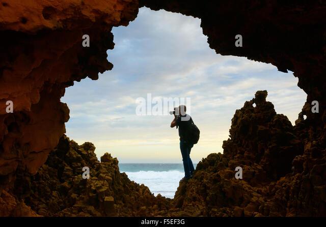Man taking a photograph at Venus Bay, Australia - Stock Image