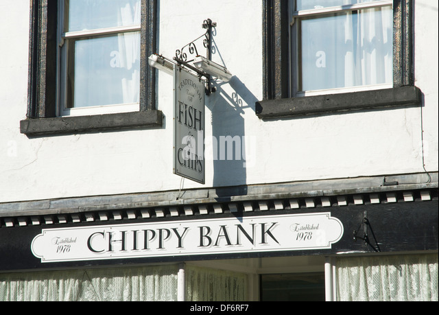 The Chippy Bank fish & chip shop in Ulverston, Cumbria, England UK - Stock Image