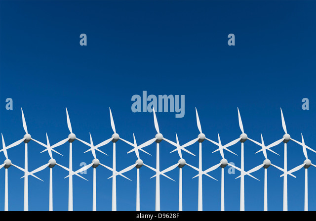 Germany, Bavaria, Wind turbine against blue sky - Stock Image