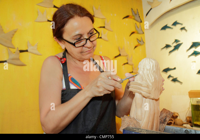 Chile Santiago Las Condes Plaza los Dominicos shopping souvenir gift shop decor handicrafts Hispanic woman artisan - Stock Image