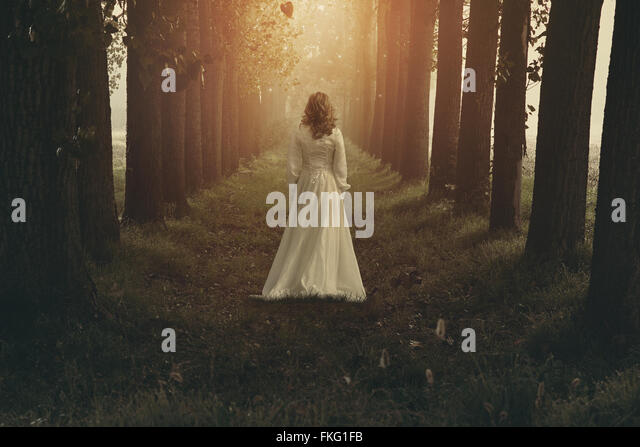 Woman with victorian dress in fairy and dreamy realm. Fantasy manipulation - Stock-Bilder