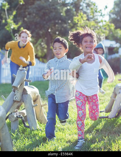 Children running on playground - Stock Image