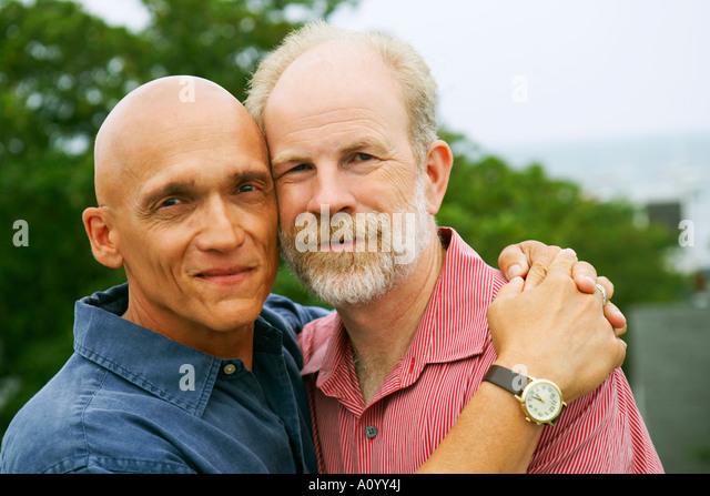 Gay couple hugging - Stock Image