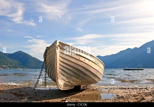 a rowing boat on Lake Maggiore, Ticino - Stock Image