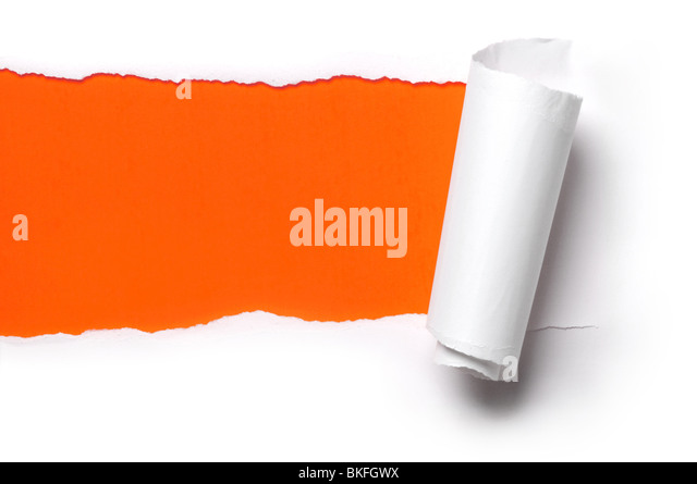ripped white paper against a orange background - Stock Image