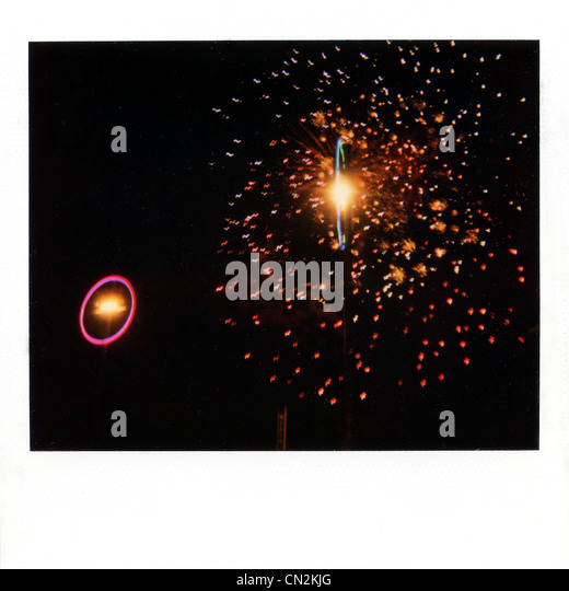 Instant film photograph of firework display - Stock Image