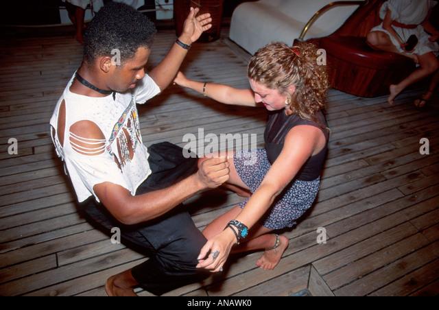Venezuela Caribbean Sea Barefoot Windjammer SV Fantome schooner cruise dancing Black male - Stock Image