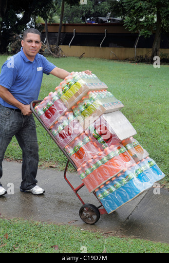 Panama City Panama Amador beverage distributor Gatorade PepsiCo packaged bottles sports drink dolly hand truck Hispanic - Stock Image