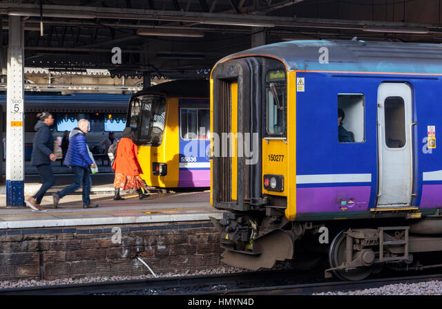 Passengers boarding trains at Sheffield Railway Station, Sheffield, England,UK - Stock Image