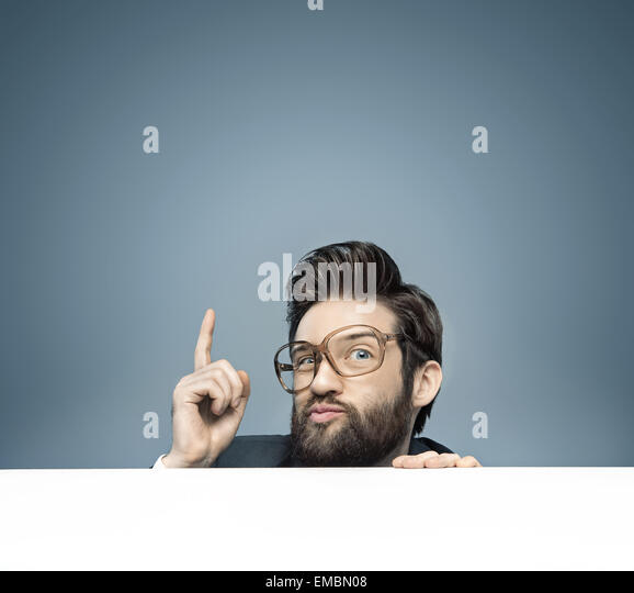 Young manager warning us against something - Stock Image