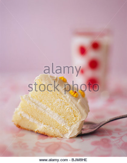 Small Piece of White Layer Cake on a Spoon - Stock Image