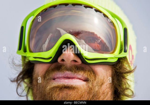 Mountain peak reflected in the goggles of a freestyle skier, Hochfuegen, North Tyrol, Austria, Europe - Stock Image