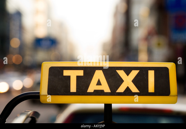 Lighted taxi sign, Germany - Stock-Bilder