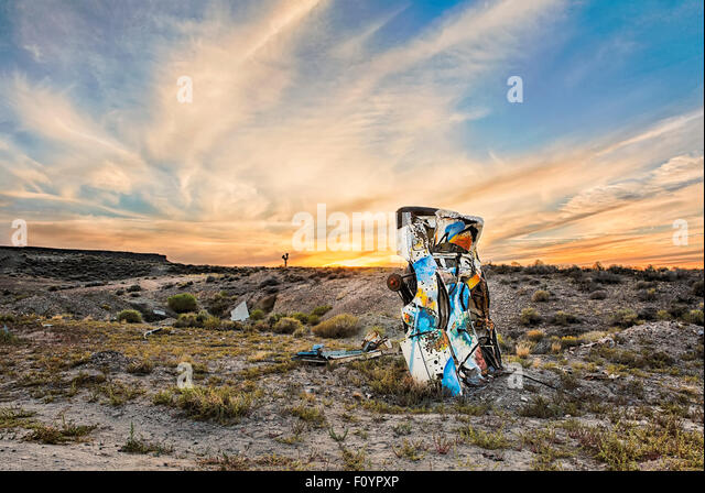 Junk car artistically buried in the desert near Goldfield Nevada - Stock-Bilder