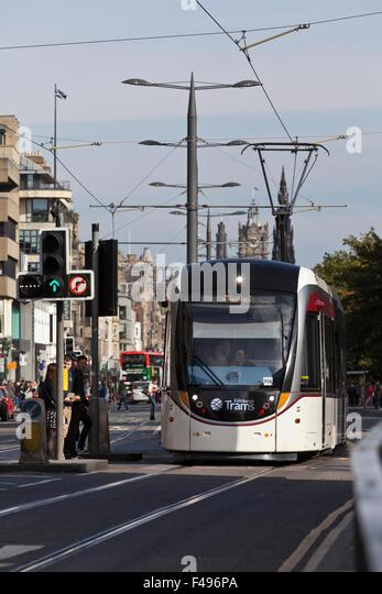 Edinburgh tram at the West end of Princes Street. - Stock Image