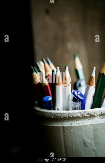 A pot of sharpened coloured lead pencils. - Stock Image