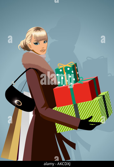 Portrait of a woman carrying Christmas presents - Stock-Bilder