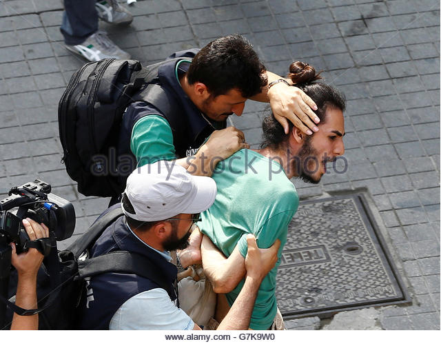Plainclothes police officers detain LGBT rights activists as they try to gather for a pride parade, which was banned - Stock-Bilder
