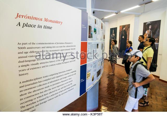 Lisbon Portugal Belem Mosteiro dos Jeronimos Jeronimos Monastery museum interpretive exhibit Asian man boy reading - Stock Image