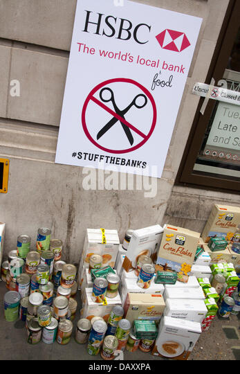 London, UK. 20th July, 2013. Activists created a 'food bank' as UK Uncut hold demonstrations outside two - Stock Image