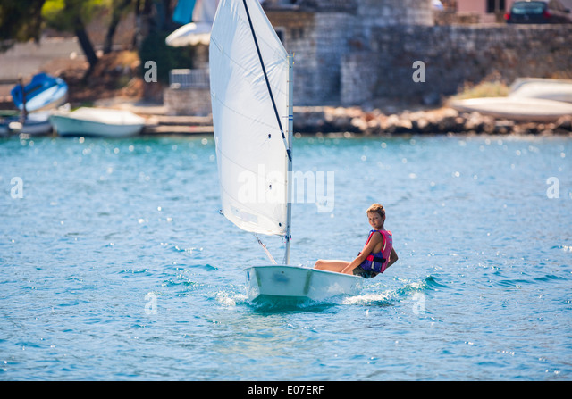 Boy in a sailboat, Hvar island, Croatia - Stock Image