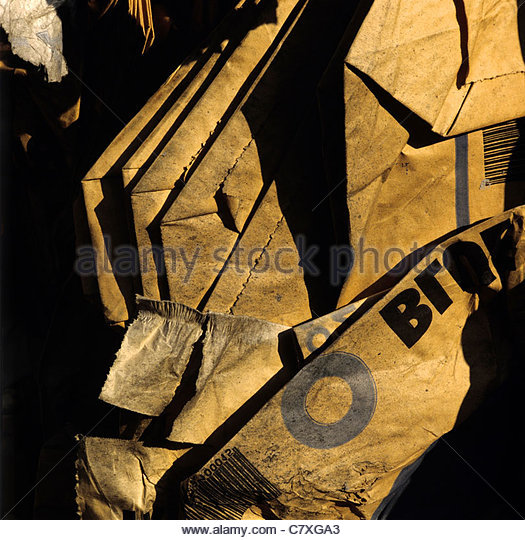 Compressed pile of paper products, recycling - Stock Image