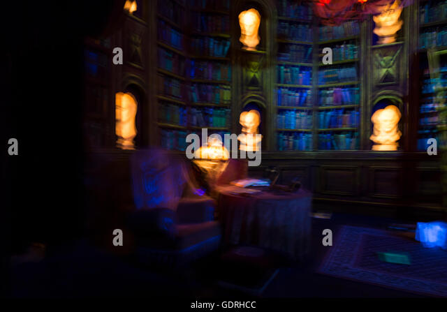 Colorful blurred image symbolizing dreams, nightmares and ghostly apparitions. View on an imaginary library with - Stock Image