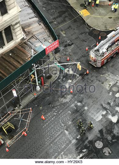 New York City, USA. 31st Mar, 2017. Firefighters are at work as multiple manhole explosions occurred near Broadway - Stock Image