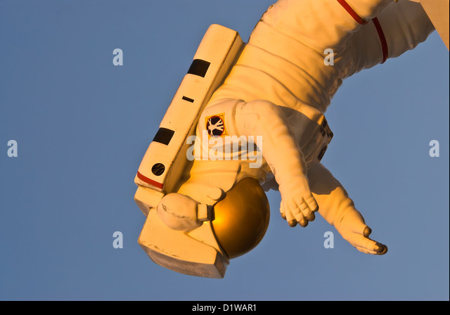 Model of NASA astronaut floating upside down in space weightlessness Kennedy Space Center Visitor Center, Florida - Stock Image