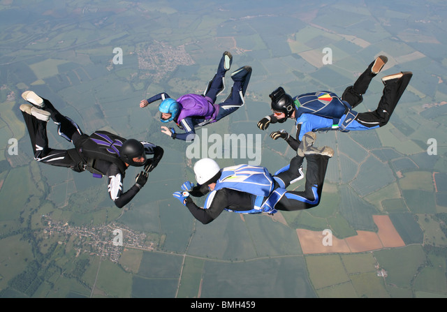 Four skydivers in freefall - Stock Image
