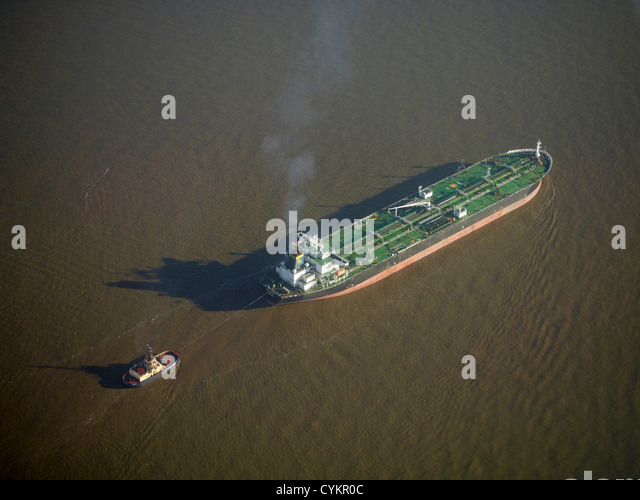 Ship entering Liverpool Docks at the mouth of the River Mersey, North West England, UK - Stock-Bilder