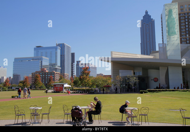 Georgia Atlanta downtown Pemberton Place World of Coca-Cola lawn skyline building man boy Bank of America Tower - Stock Image