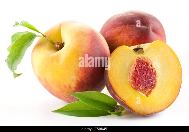 Ripe peach fruit with leaves and slises on white background. - Stock Image