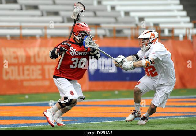 May 7, 2011 - Syracuse, New York, U.S - Saint John's Red Storm midfielder Ryan Herits (30) pushes the stick - Stock Image