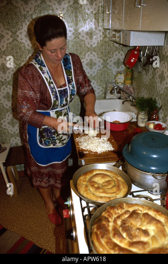 Moldova Eastern Europe Kishinev woman cooking kitchen home - Stock Image