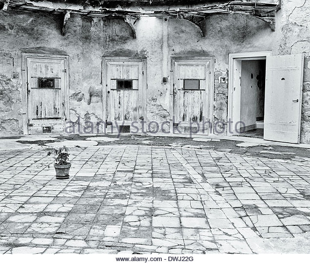 The courtyard of an abandoned mental asylum, in the Le Marche region of Italy. - Stock Image