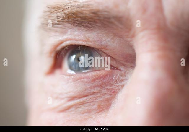 Senior man's eye, close up - Stock Image