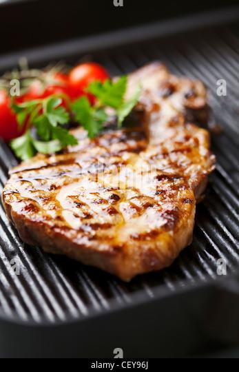 grilled pork chop - Stock Image