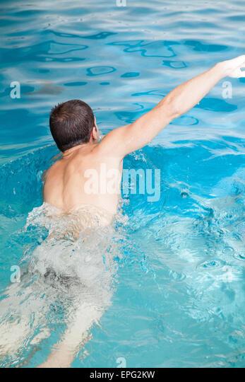 Man in the pool - Stock-Bilder
