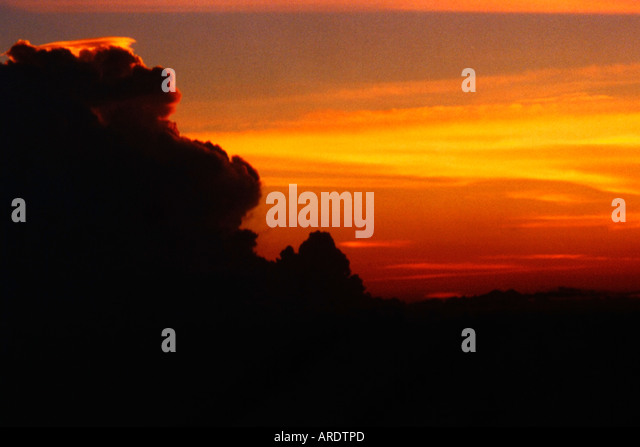 Above Storm Clouds sunset - Stock Image