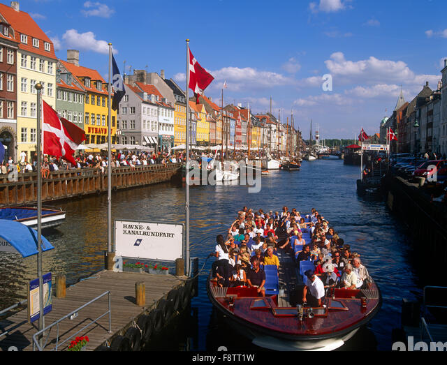 Tourists on pleasure boat, Nyhavn, Copenhagen, Denmark - Stock Image