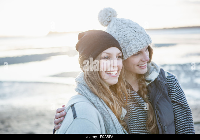 Two female friends enjoying the beach - Stock Image