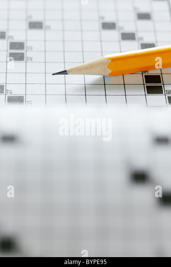 Close up of pencil on crossword puzzle. Copy space - Stock Image