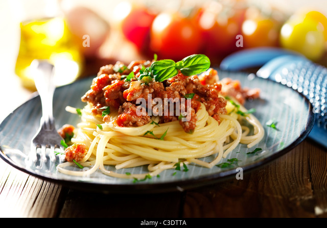 fresh pasta bolognese with basil - Stock Image