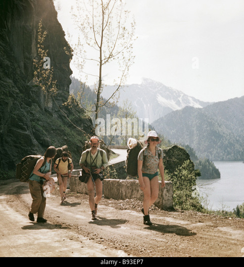 Tourists travel in the Abkhazia mountains - Stock Image